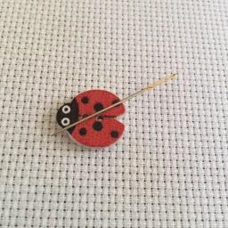 Needle Minder Red ladybug