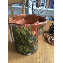 Handmade and decorated ceramic vase 10 cm.